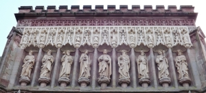 One of a set of carvings in the wall outside the Cathedral, above the main entrance.